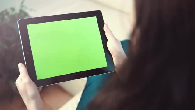 Woman Using TouchPad On Sofa: Stock Video