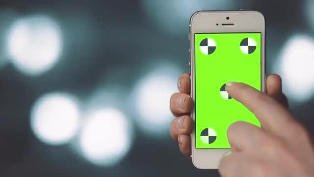 Green Screen Smartphone Over Bokeh: Stock Video