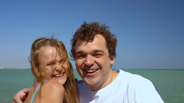 Couple Having Fun On Beach: Stock Video