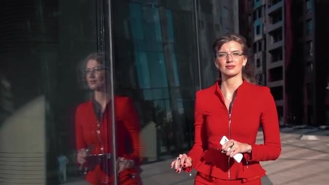Businesswoman Checking Her Reflection Outdoors: Stock Video
