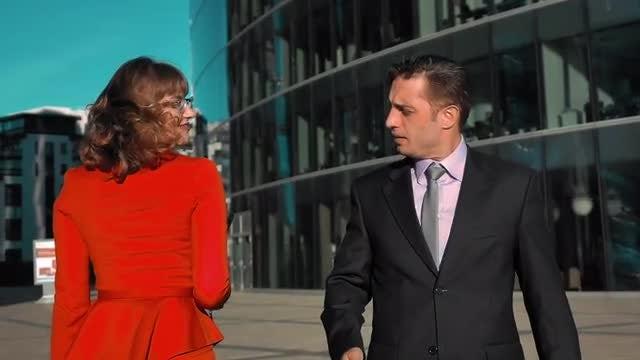 Businesswoman Flirting With Businessman: Stock Video