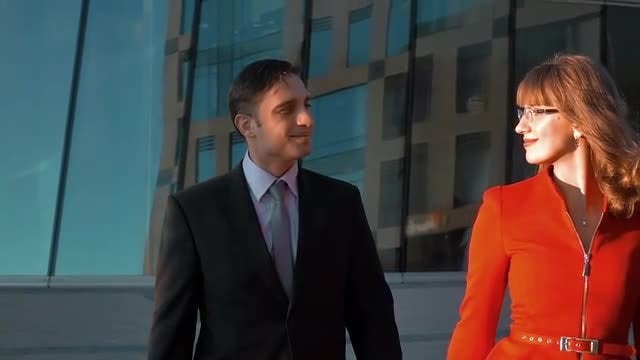 Two Smiling Business People Walking: Stock Video