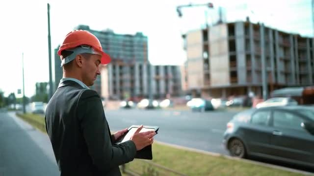 Architect Using Digital Tablet Outdoors: Stock Video
