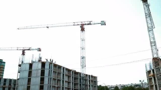 Industrial Cranes At Construction Site: Stock Video