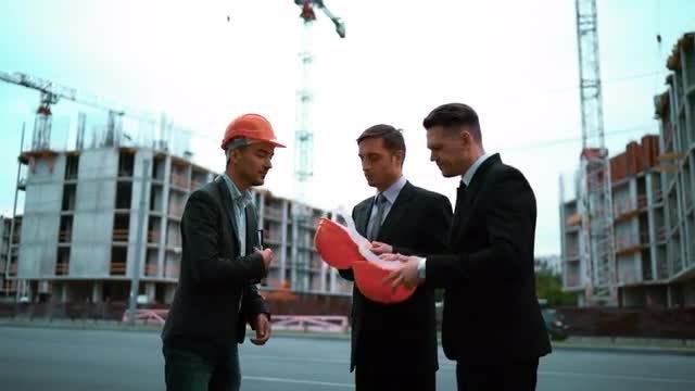 Architect Giving Businessmen Helmets: Stock Video
