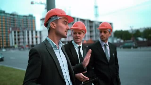 Architect And Businessmen Discussing Project: Stock Video
