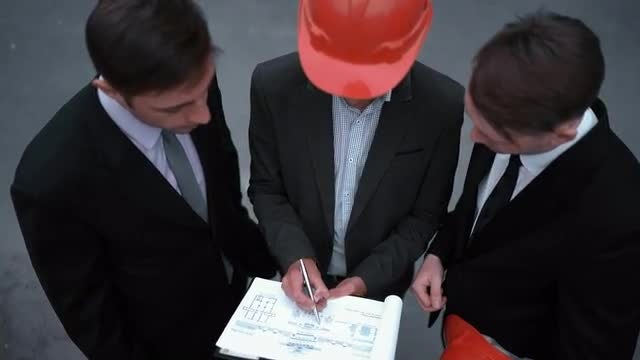 Businessmen Signing Architecture Documents: Stock Video