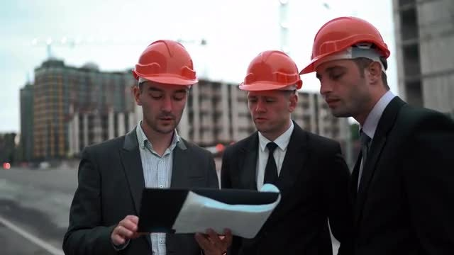 Young Architects Discussing A Blueprint: Stock Video