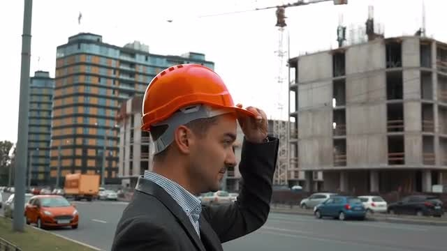 Engineer Putting On Hard Hat: Stock Video