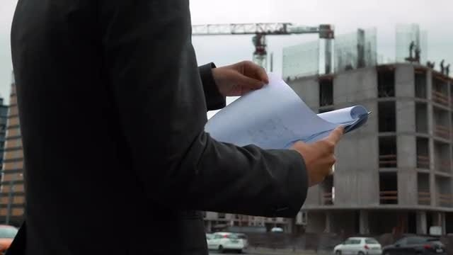 Project Manager Checking Construction Plan: Stock Video