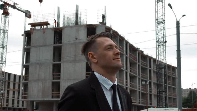 Businessman Walking Near Construction Site: Stock Video