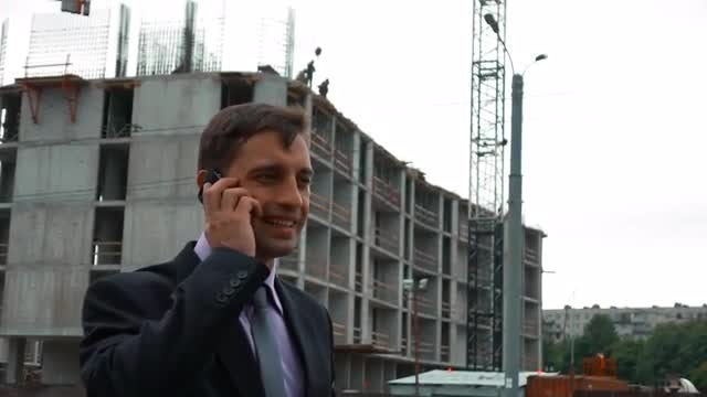 Construction Engineer Answering A Call: Stock Video