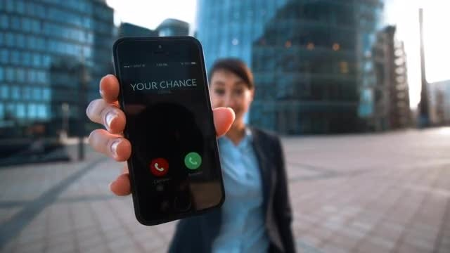 Woman Receives Call On Smartphone: Stock Video