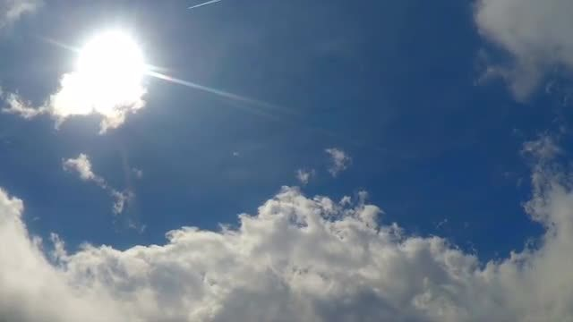 White Clouds And Flaring Sun: Stock Video