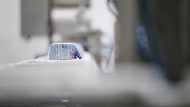 Taking  Ice Cream From Conveyor: Stock Video