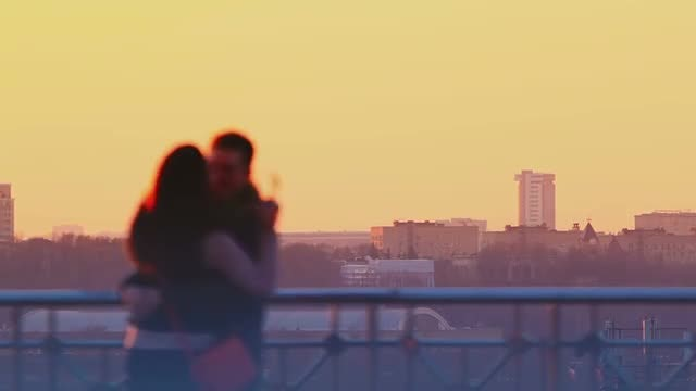 Young Couple Kissing At Sunset: Stock Video