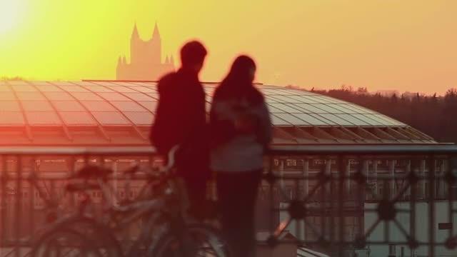 Romantic Couple Watches Sunset: Stock Video