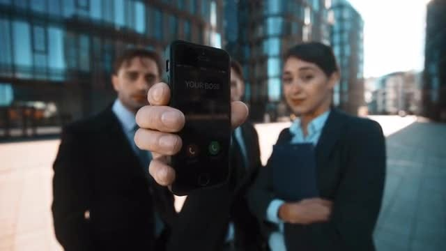 Man Receives Call From Boss: Stock Video