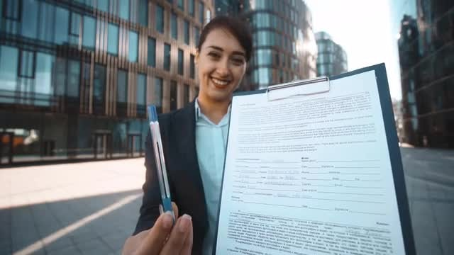 Young Businesswoman Asking For Signature: Stock Video