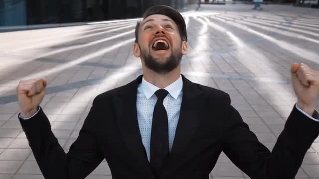 Ecstatic Businessman Shouts From Happiness: Stock Video