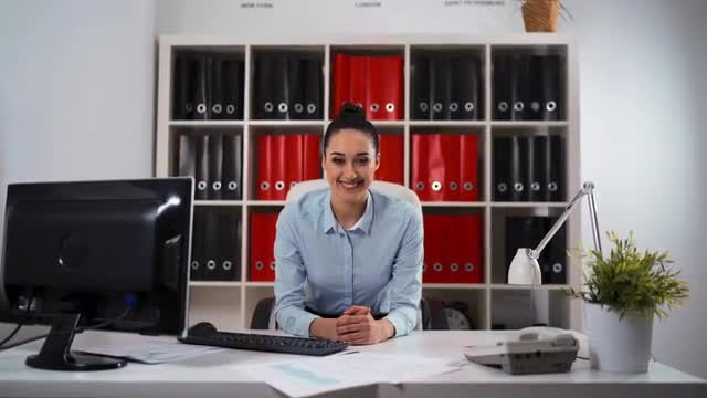 Businesswoman In The Office Smiling: Stock Video