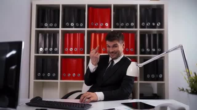 Businessman Flipping The Bird: Stock Video