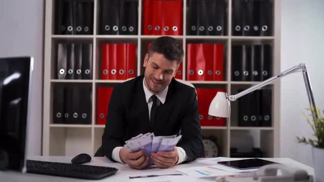 Happy Businessman Counting Euro Bills: Stock Video