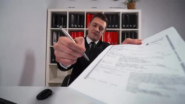 Young Salesman Presenting A Contract: Stock Video