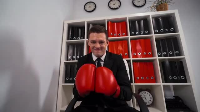 Angry Businessman With Boxing Gloves: Stock Video