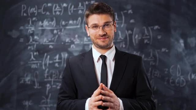 Male Scientist Explaining An Equation: Stock Video