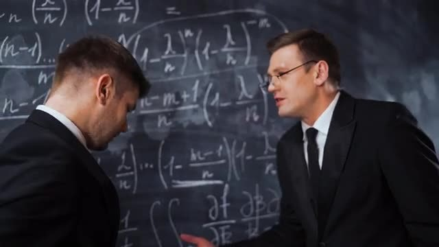 Two Male Scientist Discussing Equations: Stock Video