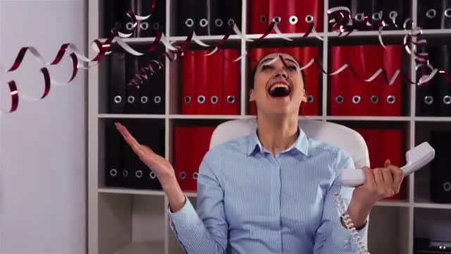 Businesswoman Celebrating A Big Win: Stock Video