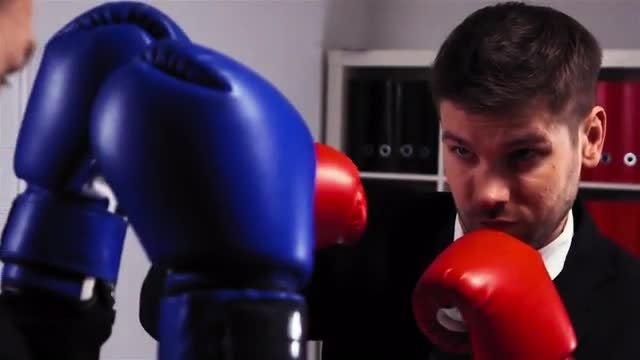 Businessmen Boxing In The Office: Stock Video