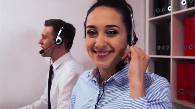 Call Center Employee Smiling: Stock Video