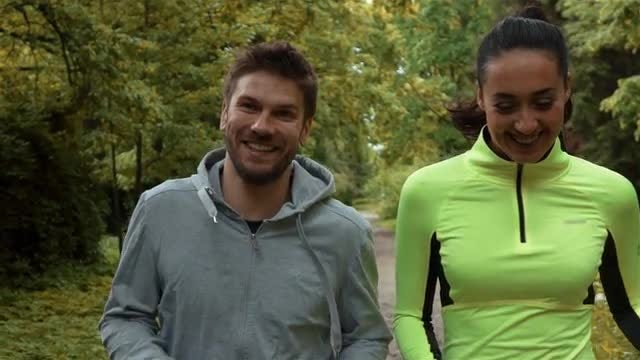 Male And Female Jogger In The Park: Stock Video
