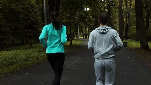Couple Jogging In Slow Motion: Stock Video