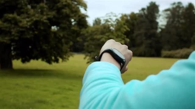 Woman Tracking Workout With Smartwatch: Stock Video