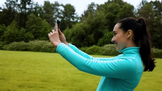 Female Jogger Taking A Selfie: Stock Video