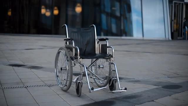 Empty Wheelchair Rolling On Floor: Stock Video