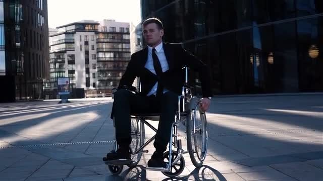 Businessman In A Wheelchair Turning: Stock Video