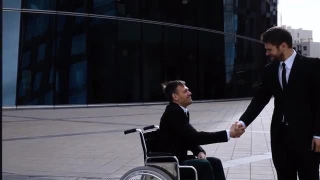 Male Business Partners Shaking Hands: Stock Video