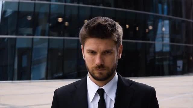 Close-up Shot Of Serious Businessman: Stock Video