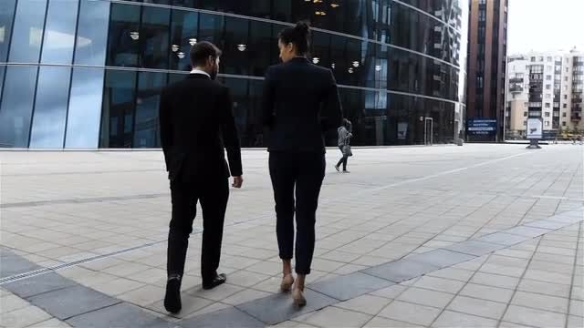 Colleagues Walking Outside Business Center: Stock Video