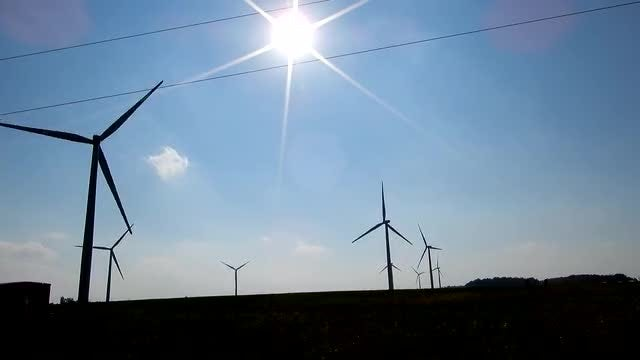 Wind Turbines And Flaring Sun: Stock Video