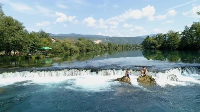 Two Boys On Waterfall Rocks: Stock Video