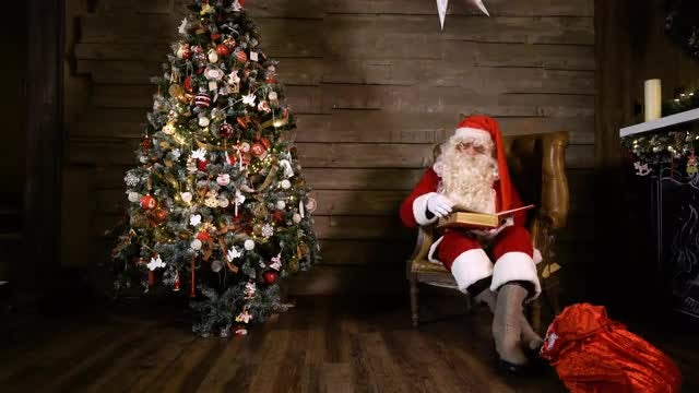 Santa Claus Is Reading: Stock Video