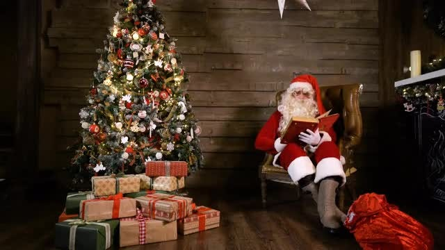Santa Claus Reading On Christmas: Stock Video