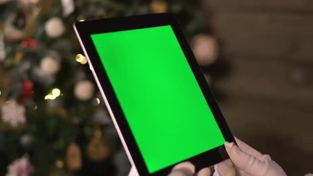 Santa Chooses Gifts Using Tablet: Stock Video