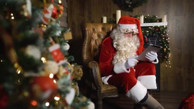 Santa Claus Using An iPad: Stock Video