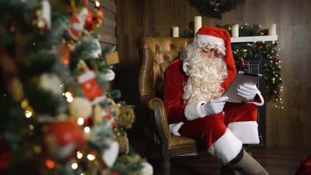 Santa Claus Working Using Tablet: Stock Video